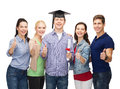 Group of students with diploma showing thumbs up education and people concept standing smiling and corner cap Royalty Free Stock Images