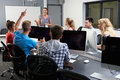 Group Of Students With Female Tutor In Computer Class Royalty Free Stock Photo