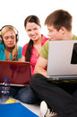 Group of students having fun, doing home work Royalty Free Stock Photo