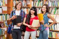 Group of students in a library Royalty Free Stock Image