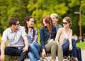 Group of students or teenagers hanging out summer holidays education campus and teenage concept Royalty Free Stock Image