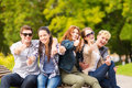 Group of students or teenagers showing thumbs up summer holidays education campus and teenage concept Stock Image