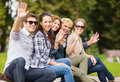 Group of students or teenagers waving hands summer holidays education campus and teenage concept Royalty Free Stock Images