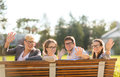 Group of students or teenagers waving hands summer holidays education campus and teenage concept in eyeglasses Royalty Free Stock Images
