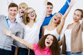 Group of students young happy people in classroom screaming joyfully Royalty Free Stock Photo