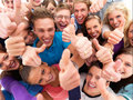 Group of successful students giving the thumbs up Stock Image