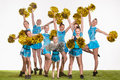 The group of teen cheerleaders posing at white studio Royalty Free Stock Photo
