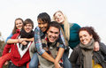 Group Of Teenage Friends Having Piggyback Rides Royalty Free Stock Images