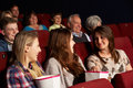 Group Of Teenage Girls Watching Film In Cinema Stock Images