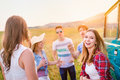 Group of teenage hipsters on a roadtrip having fun young friends outside summer day Stock Image