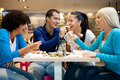 Group of teenagers enjoying in lunch happiness at restaurant Stock Photo