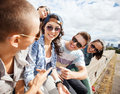 Group of teenagers hanging out summer holidays and teenage concept outside Stock Image