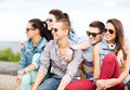 Group of teenagers hanging out summer holidays and teenage concept outside Stock Photo