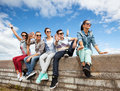 Group of teenagers hanging out summer holidays and teenage concept outside Royalty Free Stock Photo