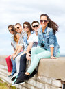 Group of teenagers hanging out summer holidays and teenage concept outside Royalty Free Stock Photography