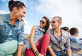 Group of teenagers hanging out summer holidays and teenage concept outside Royalty Free Stock Images