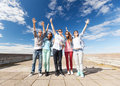 Group of teenagers holding hands up summer holidays and teenage concept outside Royalty Free Stock Photo