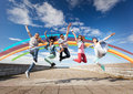Group of teenagers jumping Stock Image