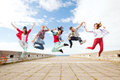 Group of teenagers jumping summer sport dancing and teenage lifestyle concept Stock Photo