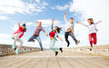 Group of teenagers jumping summer sport dancing and teenage lifestyle concept Royalty Free Stock Photo