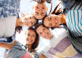 Group of teenagers looking down summer holidays and teenage concept Royalty Free Stock Photo