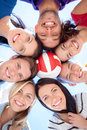 Group of teenagers looking down summer holidays vacation happy people concept with ball Stock Photos