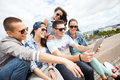 Group of teenagers looking at tablet pc summer holidays teenage and technology concept Stock Photo