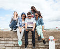 Group of teenagers looking at tablet pc summer holidays teenage and technology concept Royalty Free Stock Images
