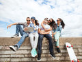 Group of teenagers looking at tablet pc summer holidays teenage and technology concept Stock Photography