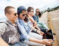 Group of teenagers looking at tablet pc summer holidays teenage and technology concept Royalty Free Stock Photos