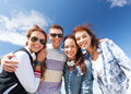 Group of teenagers outside summer holidays and teenage concept Royalty Free Stock Photo