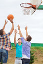 Group of teenagers playing basketball summer vacation holidays games and friendship concept outdoors Royalty Free Stock Image