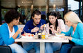 Group of teenagers students on lunch in restaurant Stock Images