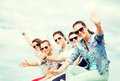 Group of teenagers waving hands summer holidays and teenage concept Royalty Free Stock Photos