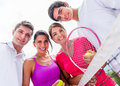 Group of tennis players happy holding rackets outdoors Royalty Free Stock Photography