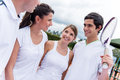 Group of tennis players happy talking at the court Stock Photo