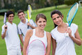 Group of tennis players looking happy outdoors Royalty Free Stock Photography
