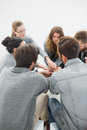 Group therapy in session sitting in a circle with therapist Royalty Free Stock Photo