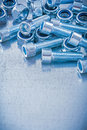 Group of threaded construction nuts and screw bolts on metallic background copy space image maintenance concept Royalty Free Stock Image