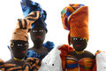 Group of three african dolls isolated wearing traditional costume Royalty Free Stock Photo