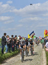 Group of three cyclists paris roubaix carrefour de l arbre france april a john degenkolb giant shimano fabian cancellara trek Royalty Free Stock Photography