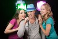 Group of three friends singing with microphone. Royalty Free Stock Photo