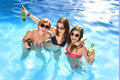 Group of three happy girl friends having bath in swimming pool t Royalty Free Stock Photo
