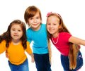Group three kids two girls boy together asian caucasian happy hugging isolated white Royalty Free Stock Images
