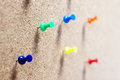 Group of thumbtacks pinned on corkboard Stock Photography