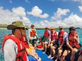 Group of tourists riding in a dinghy from Espanola Island, Galap Royalty Free Stock Photo