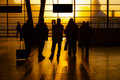 Group of traveling people silhouette at a trainstation watching the sunset Stock Photography
