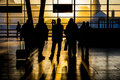Group of travelling people silhouettes a traveling at a trainstation watching the sunset Royalty Free Stock Images