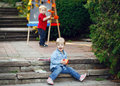 Group of two white Caucasian toddler children kids boy and girl outside in summer autumn park by drawing easel Royalty Free Stock Photo