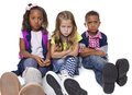 Group of unhappy and upset kids three diverse school all frowning acting isolated on white background Stock Image